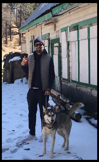 Image of Jeremy Wagshul in the snow with his dog Zeus